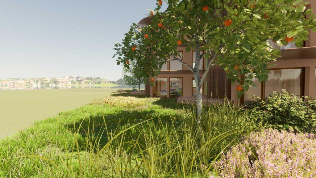 Blick durch Naturgarten zu Wohnungen